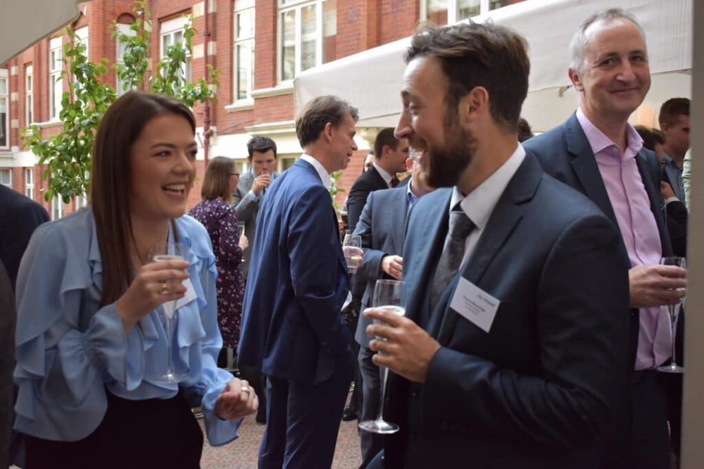 Go-Ahead graduates meet at a party before training starts
