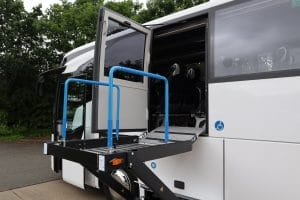 Wheelchair user lift on side of coach