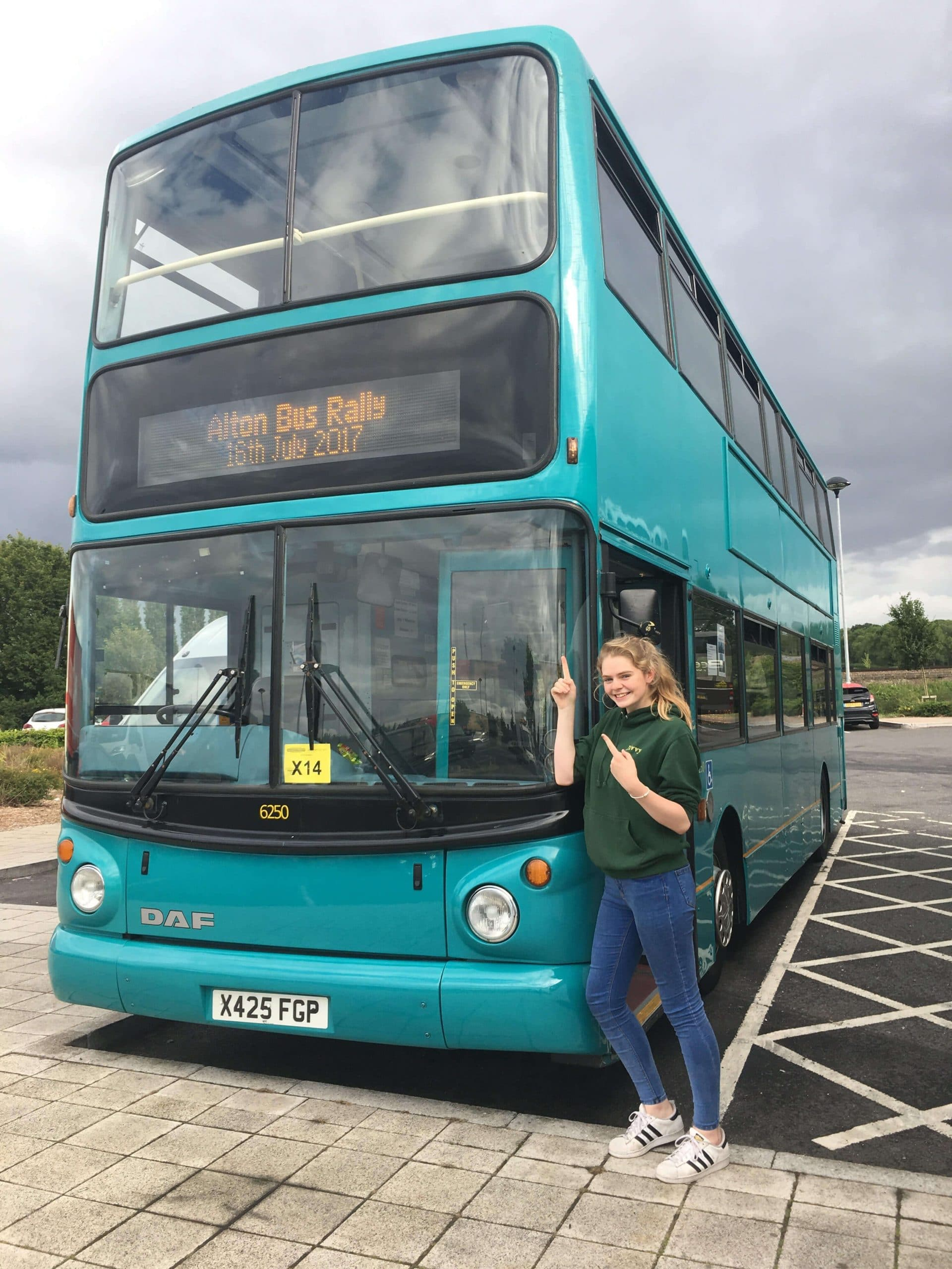 Liv with her double-decker DAF, which she bought with the help of a family friend aged 15