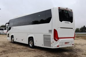 Rear view of white Scania coach